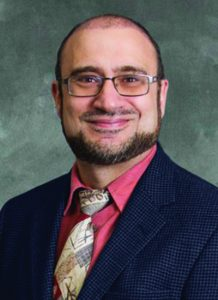Dr. Saad Farhat wearing suit and orange shirt - headshot