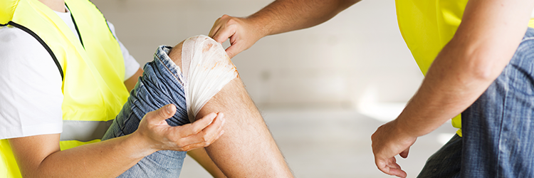 Person wrapping knee with bandage