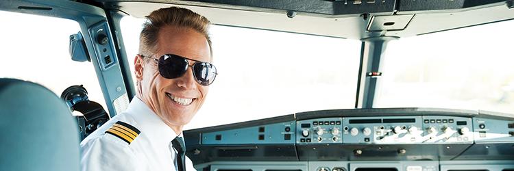 Pilot smiling in cockpit