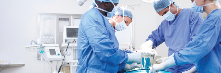 Doctors working on patient in surgery