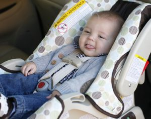 baby strapped in car seat correctly