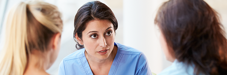 nurse speaking with patients