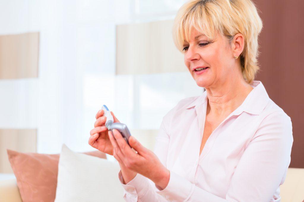 woman checking blood sugar_diabetes education