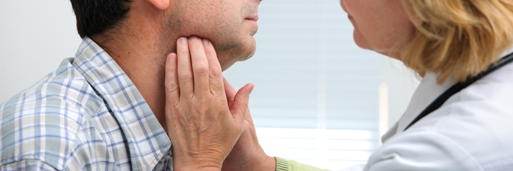 Doctor feeling patient's throat for lymph nodes