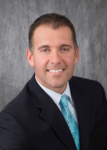 Dr. Troy Holdeman in suit - headshot