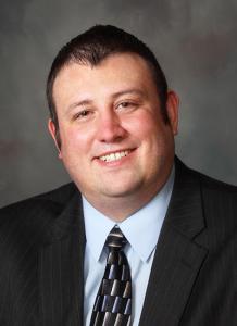 Dr. Derek Moore in suit - headshot