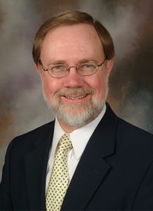 Dr. David Dennis in suit and tie - headshot