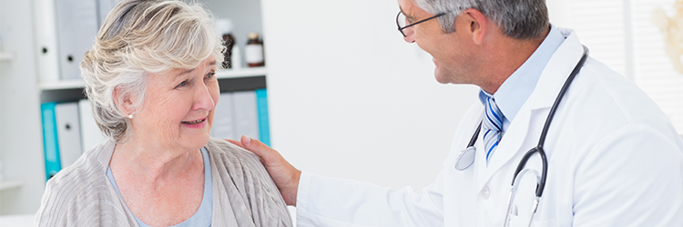 Woman consulting doctor for care - stock photo