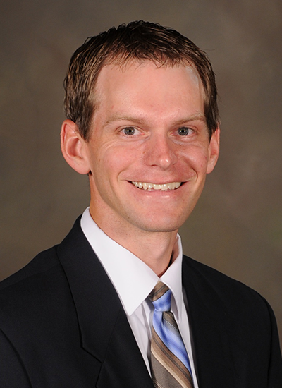 Dr. Daniel Reimer in suit - headshot