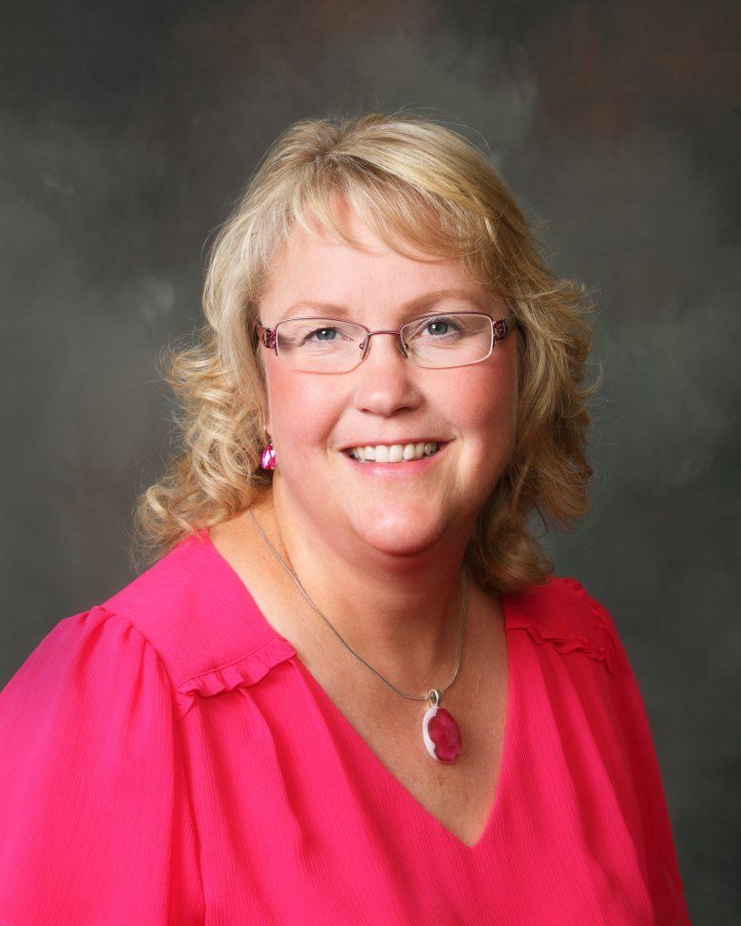 Faith Loommis in hot pink shirt - headshot
