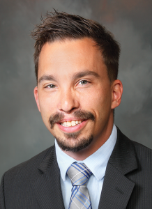 Dr. Jered Windorski wearing suit and light blue shirt and tie - headshot