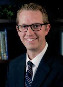 Dr. Benjamin Hawley wearing suit and tie - headshot