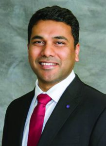 Dr. Venkata Boppana - wearing a suit and red tie - headshot