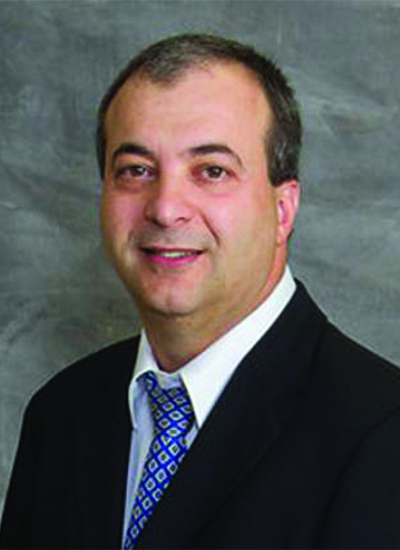 Dr. Wassim Shaheen wearing suit and blue tie - headshot