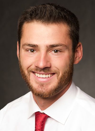 Christian Cox, PA in white button up shirt with red tie - headshot
