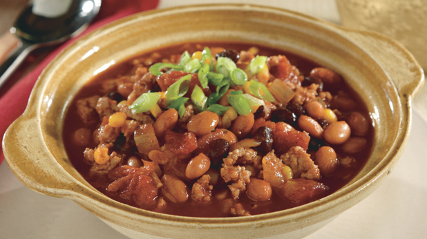 Bowl of turkey chili with green onions on top