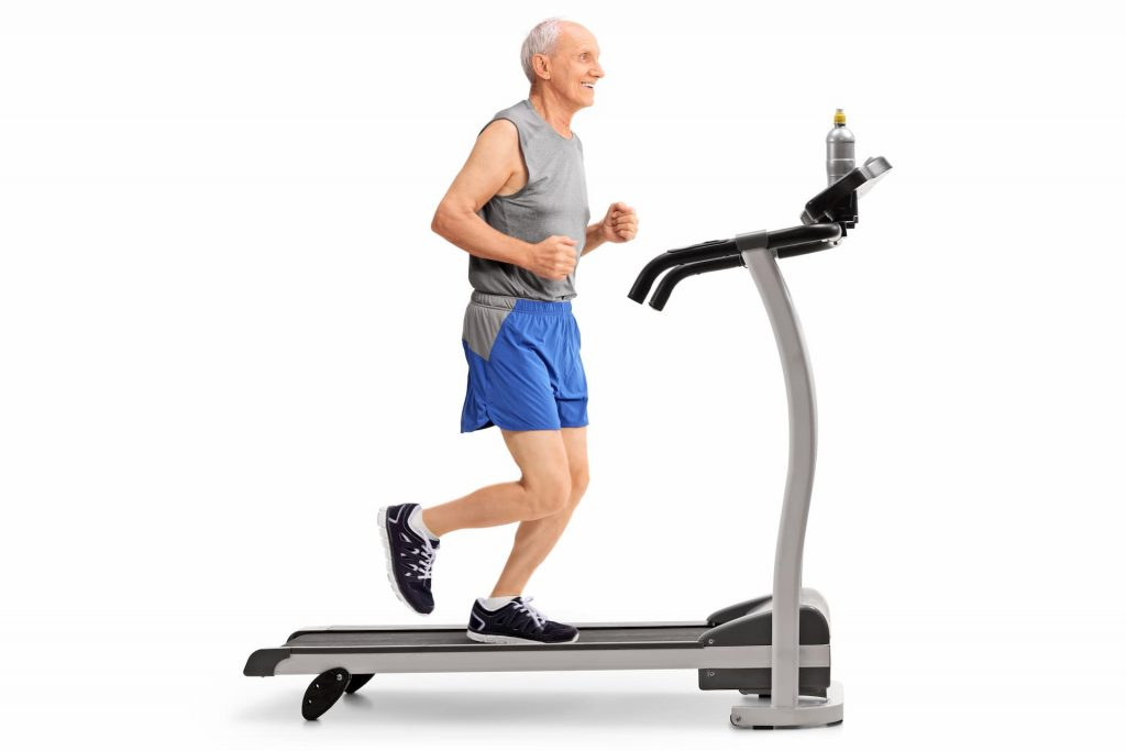 Elderly man running on treadmill