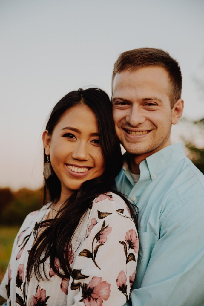 woman and husband posing and smile for camera