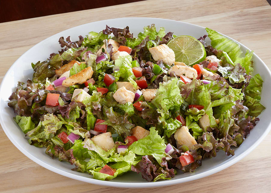 plate of pico de gallo grilled chicken salad with lime and cilantro