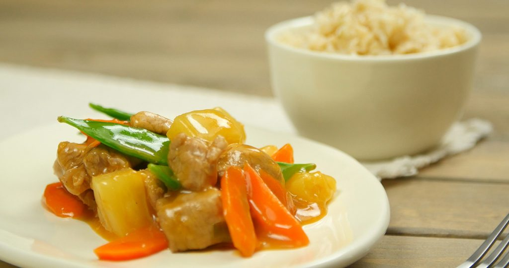 Plate of sweet and sour pork with side of rice