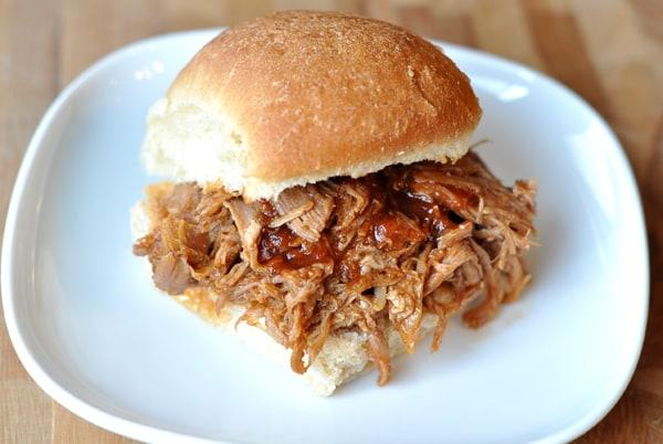 pulled pork sandwich on white plate