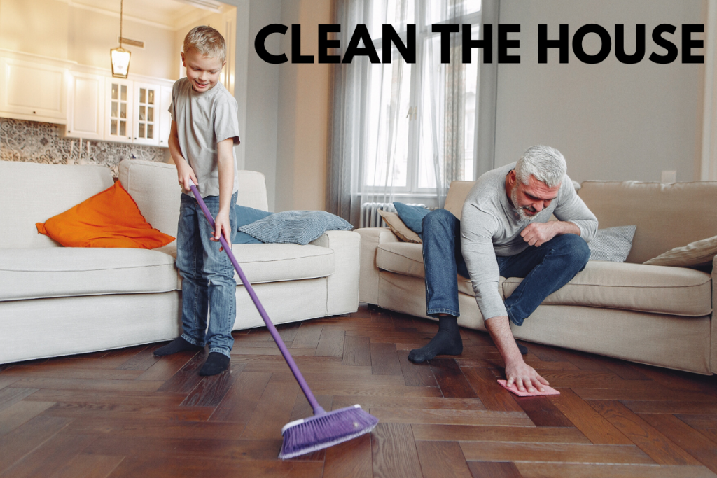 Dad and son cleaning floors in living room
