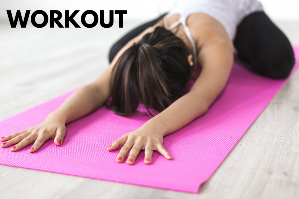 Woman doing yoga in her living room on pink mat