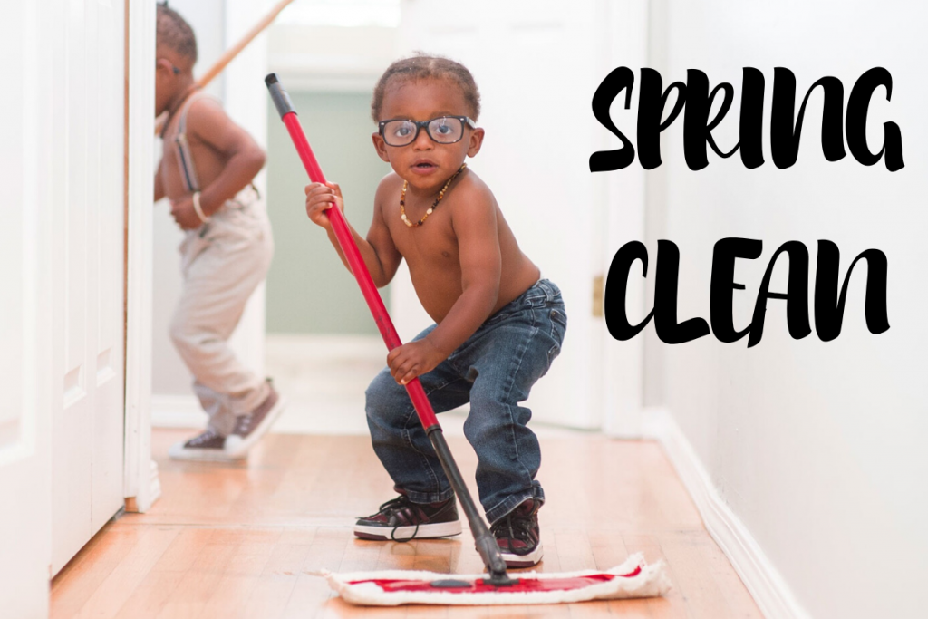 young back toddler wearing jeans and glasses mopping the floor