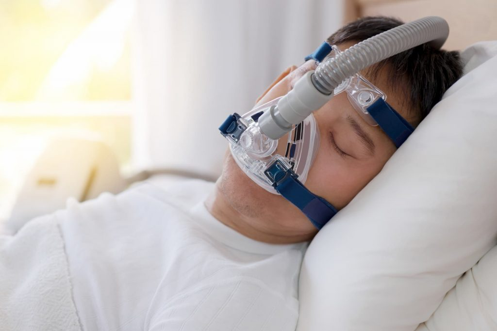 Man wearing CPAP machine for sleep apnea