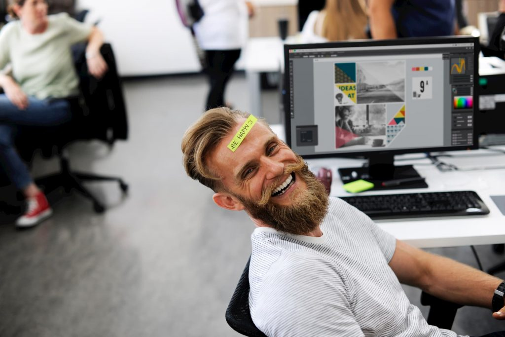 """white guy with beard smiling with """"be happy"""" sticky note stuck to his forehead - mental health awareness"""