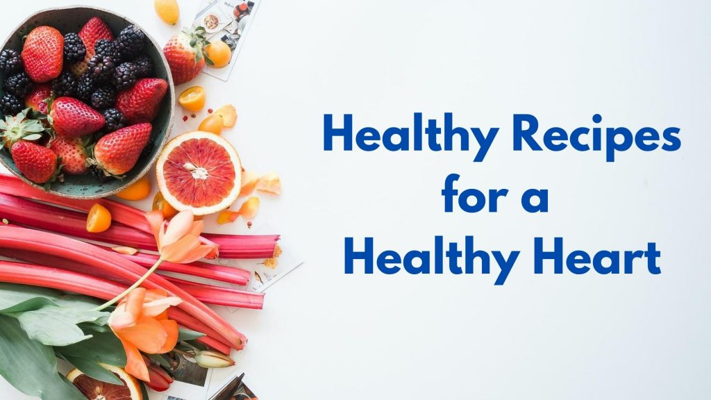 "Picture with fresh strawberries, blackberries, raspberries, grapefruit and other healthy fruits and veggies with the words ""Healthy Recipes for a Healthy Heart"" written on it in blue font"