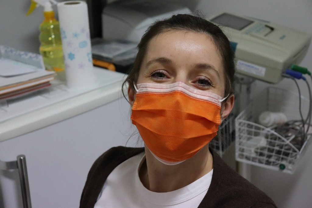 Nurse wearing orange mask