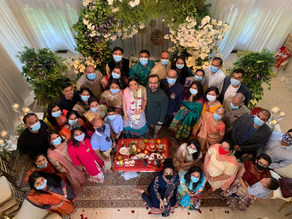 Indian family celebrating holidays with masks because of COVID-19 pandemic