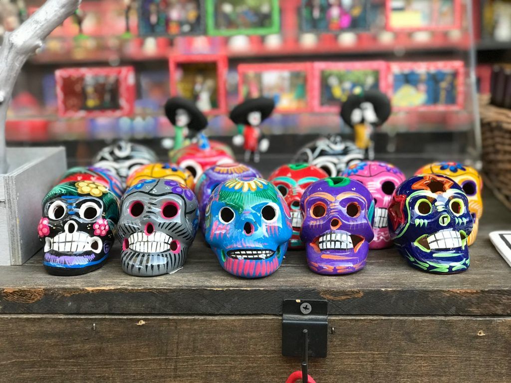 A bunch of painted sugar skulls for Dia de los Muertos - a safer way to celebrate during the COVID-19 pandemic