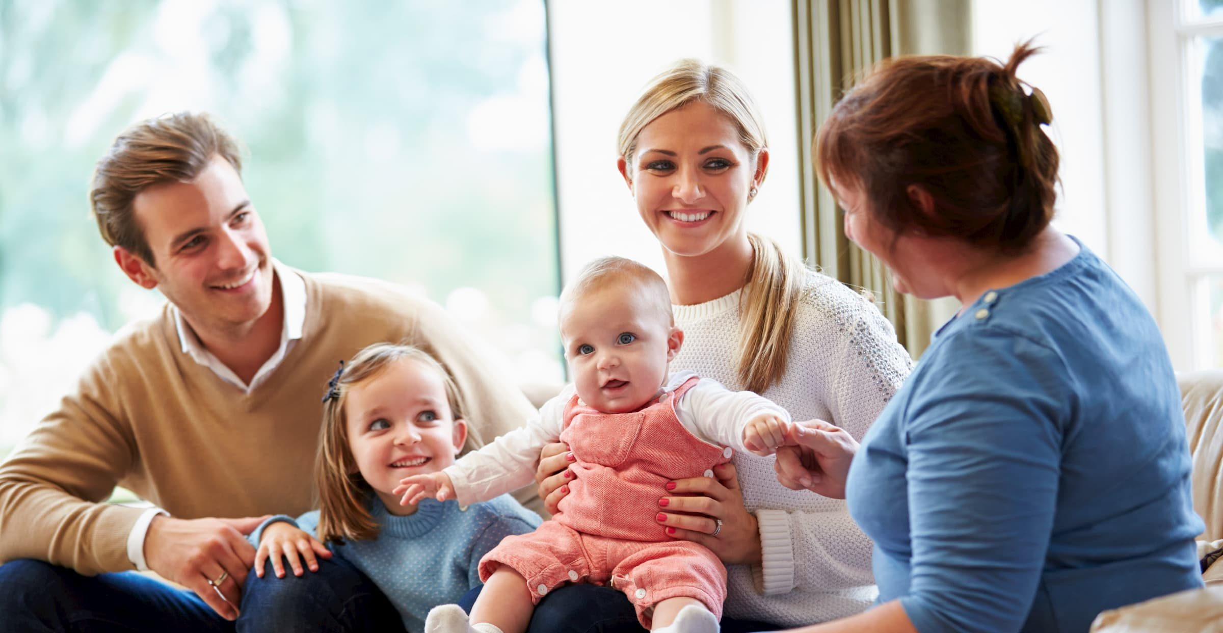 Health Visitor Talking To Family With Young Baby