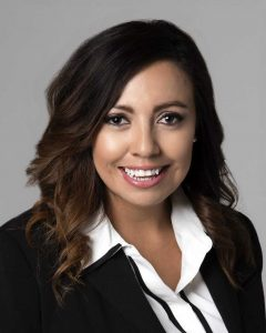 Nelly Cooper APRN Headshot photo with black suit jacket nerlyn cooper
