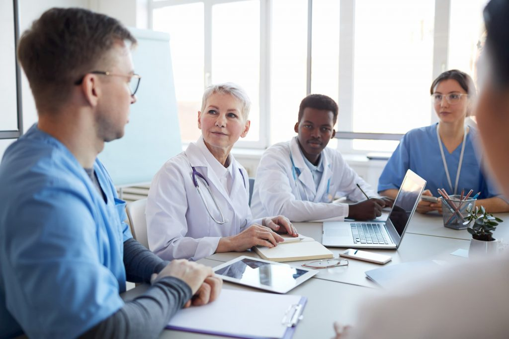 Royalty-free stock photo ID: 1674031606 Portrait of mature female doctor heading committee meeting at medical council, copy space