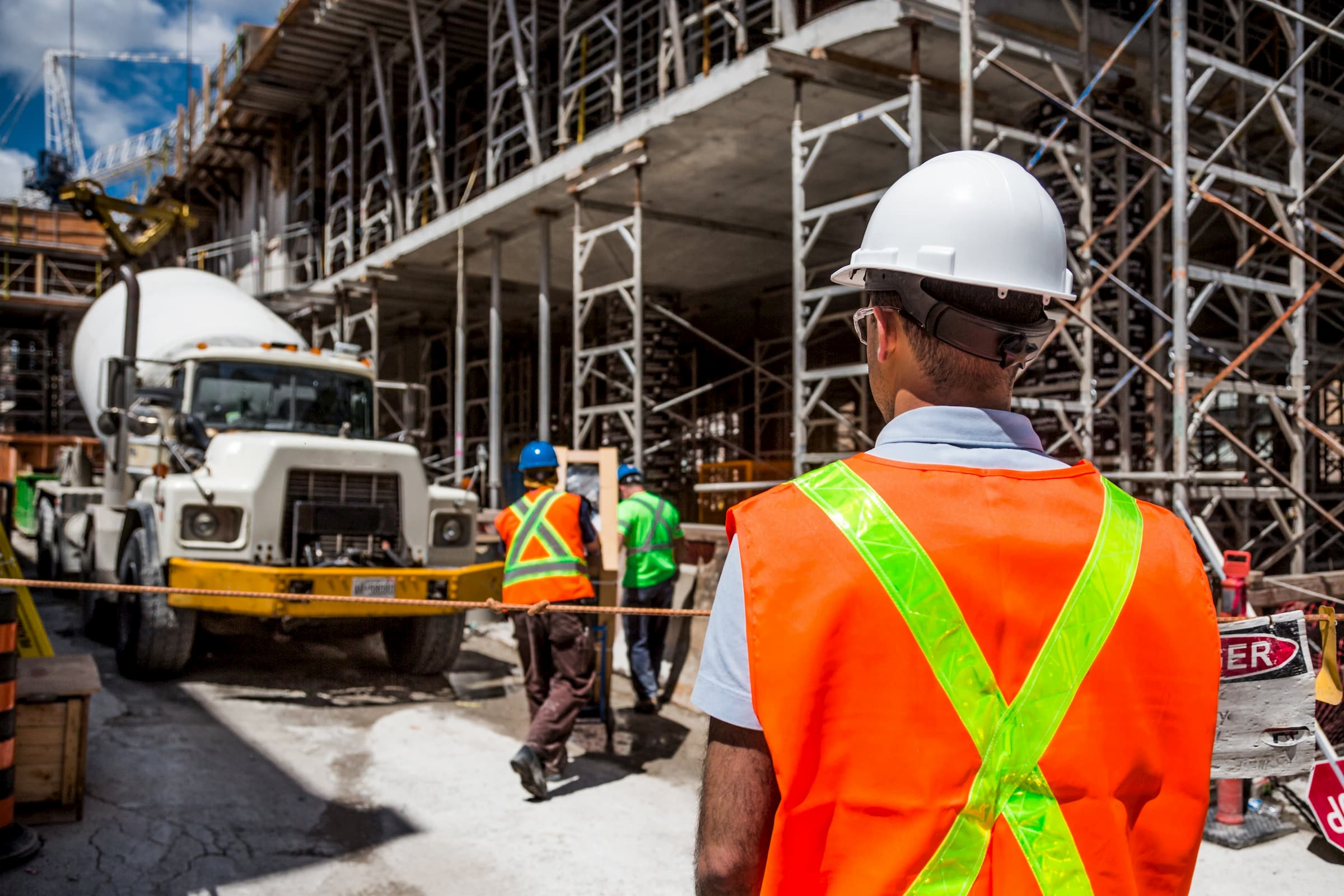 construction crew with backs to camera to show occupational medicine stock image