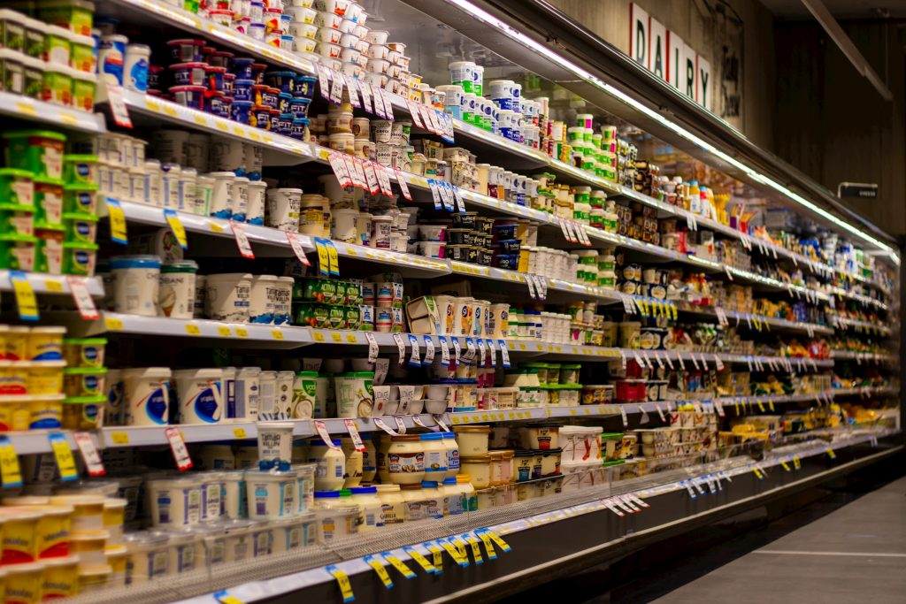 dairy aisle stock image of grocery store or supermarket