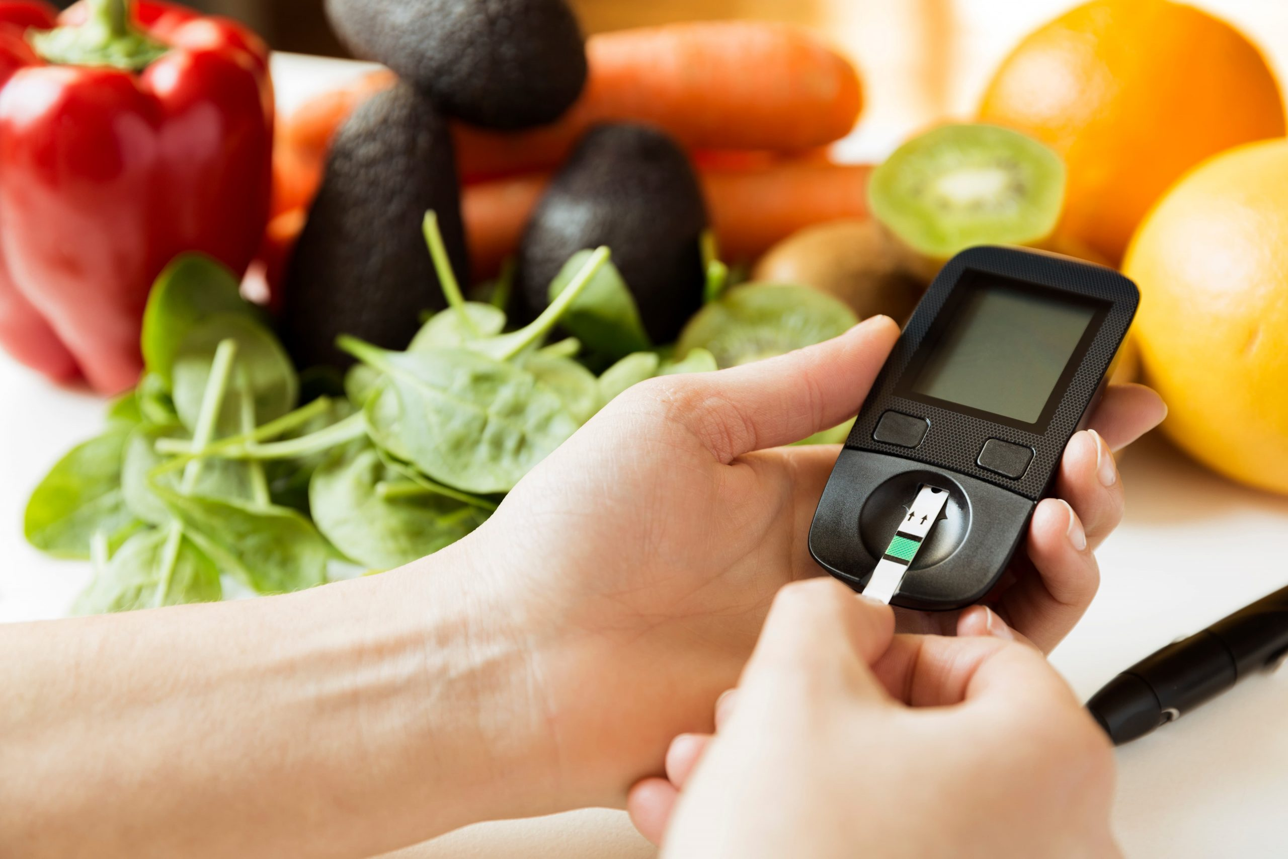 how to manage your Diabetes monitor, diet and healthy food eating nutritional concept with clean fruits and vegetables with diabetic measuring tool kitDiabetes_Education