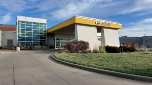 NMC Health Medical Center in Newton Ks entrance with yellow bar hospital and glass panel front entrance newton medical center