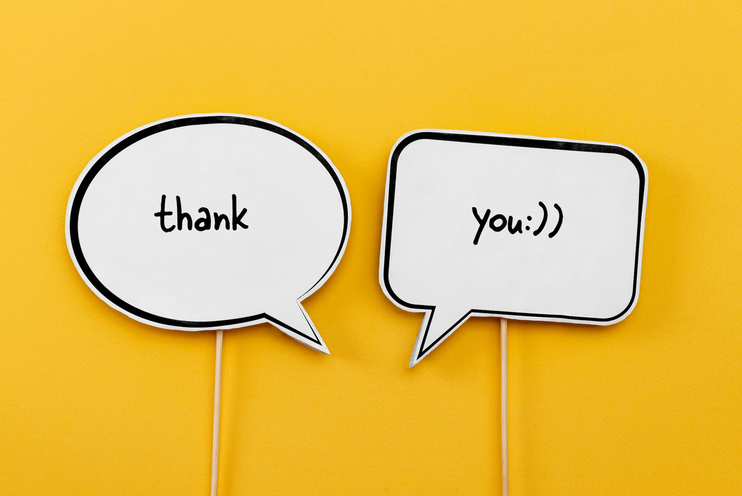 yellow back ground with speech bubble saying thank you