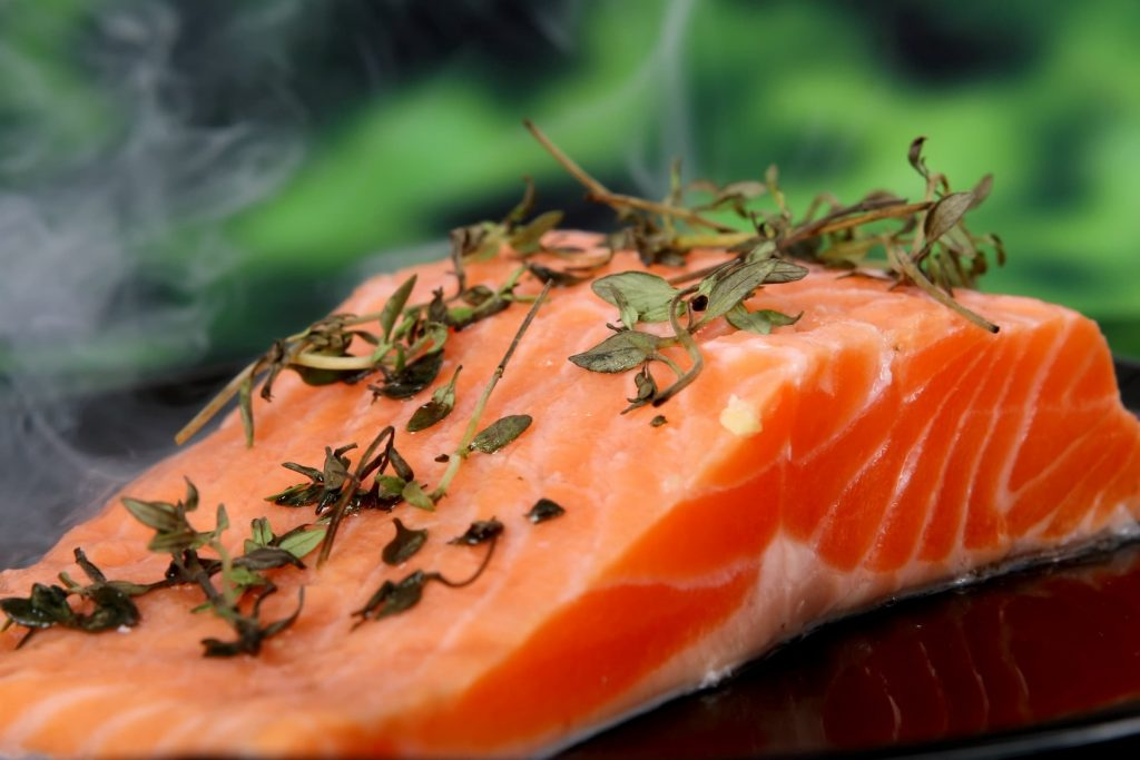 salmon filet with parsely on top close up food fish fatty acids and heart-healthy recipes healthy fats