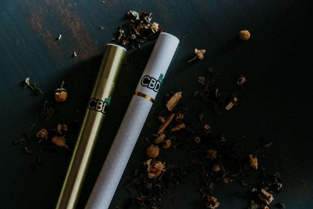 two vape pens with cbd thc marijuana products smoking vaping