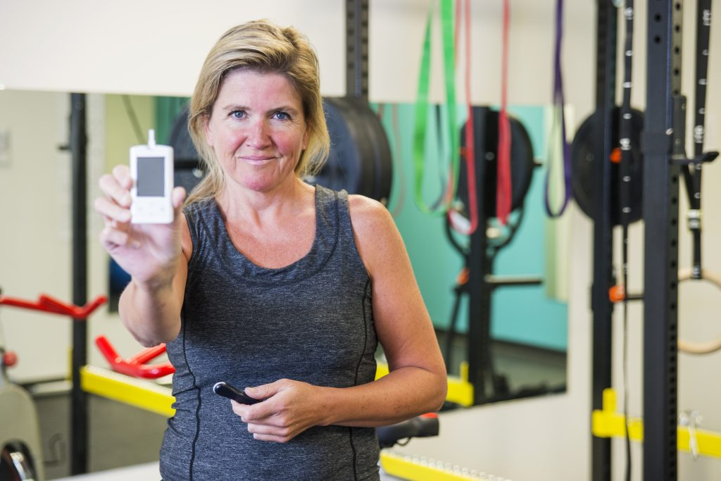middle-aged white woman working out exercising and taking blood sugar to show how exercise affects blood sugar