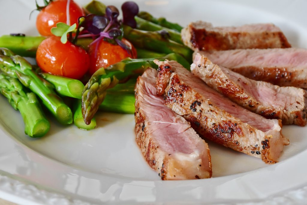 delicious health food recipe on plate meat with taomatoes and asparagus carb counting diet and exercise for managing diabetes